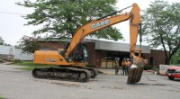 Excavator scores the parking lot