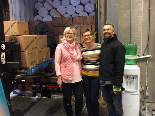 Kim Lester, Katie and Jason Buchnea at MCC, with our hygiene kits already packed in a container destined for Lebanon